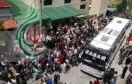 عند مدخل مجمع الرسول الاعظم بمدينة اللاذقية وصول 600 شخص من أهالي كفريا والفوعة قادمين من مركز جبرين للإقامة المؤقتة في حلب وسط استقبال شعبي