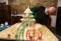 أخصائي الأشعة المصري أحمد حسن يبني نموذجاً لمعبد السماء الصيني من أعواد الثقاب